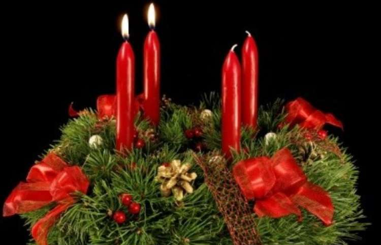 Advent wreath with 2 candles lit.