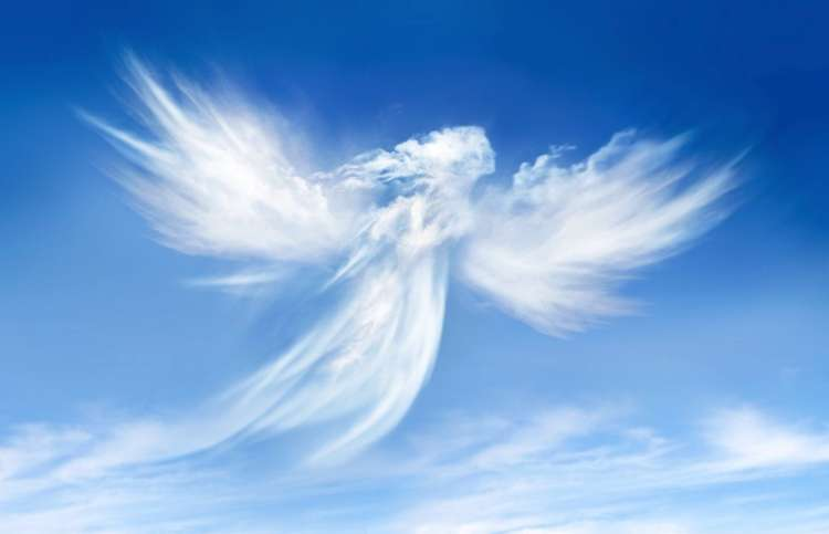 angel in the sky made out of clouds