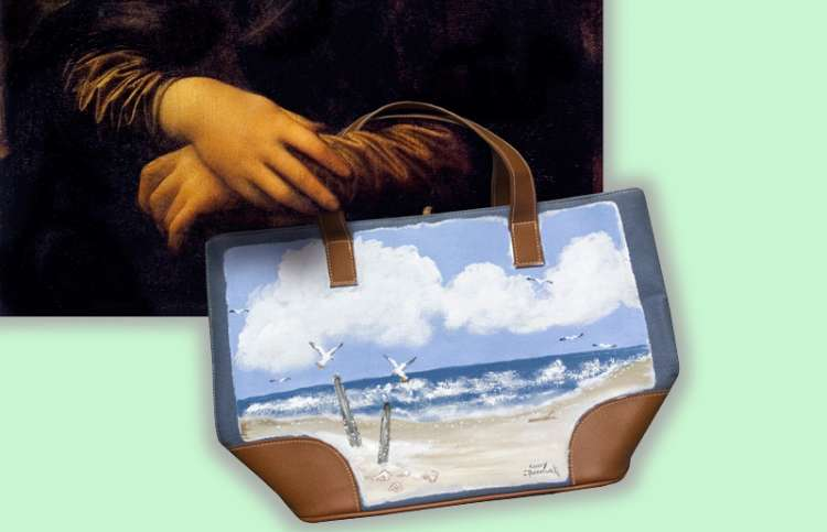 Mona Lisa's hands holding one of Cindy's painted tote bags
