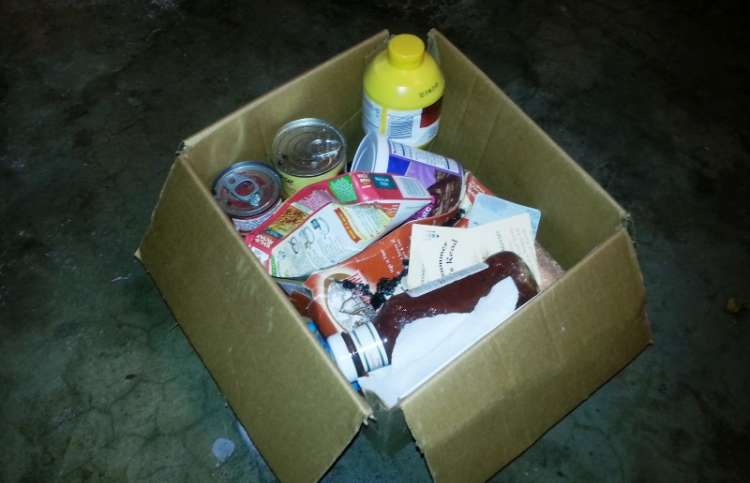 a box of items to be donated to a food pantry