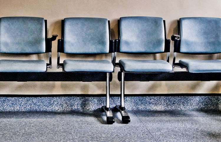 Empty chairs in a hospital waiting room