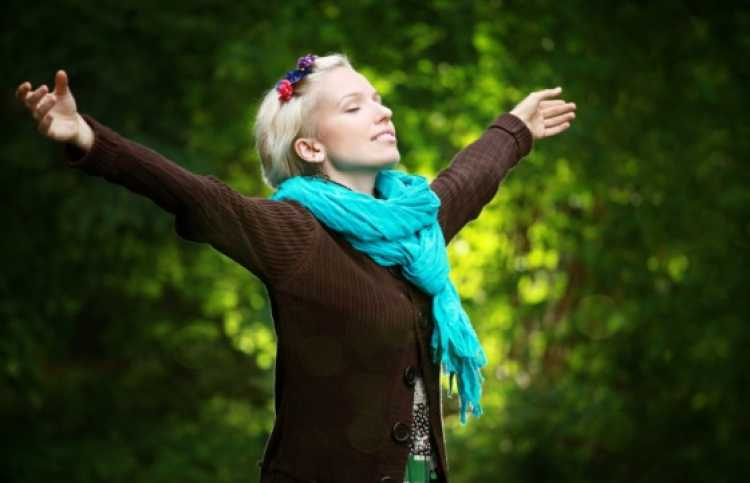 blissful woman with arms outstretched