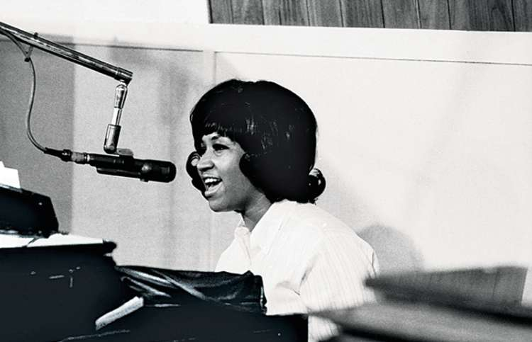 Aretha Franklin plays and sings in the recording studio.