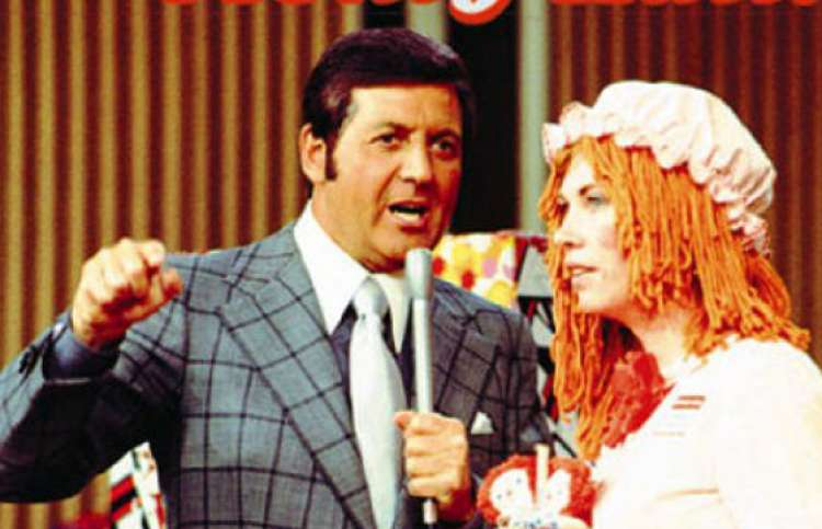 "Monty Hall tempts a contestant on ""Let's Make a Deal."""