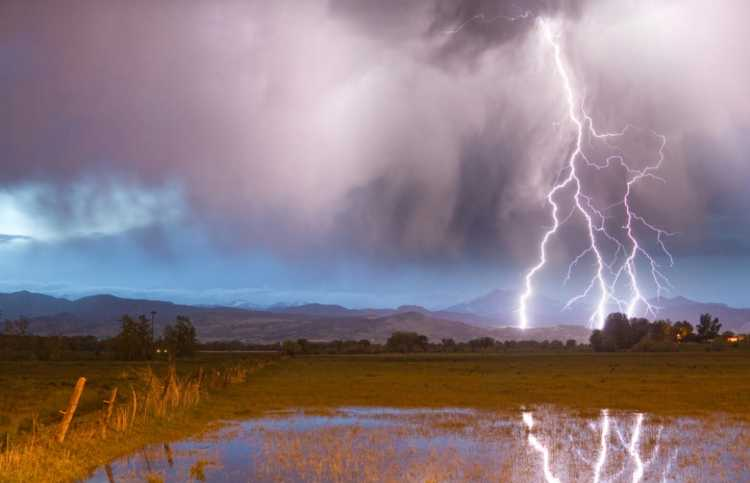 a bolt of lightning against a beautiful stormy sky