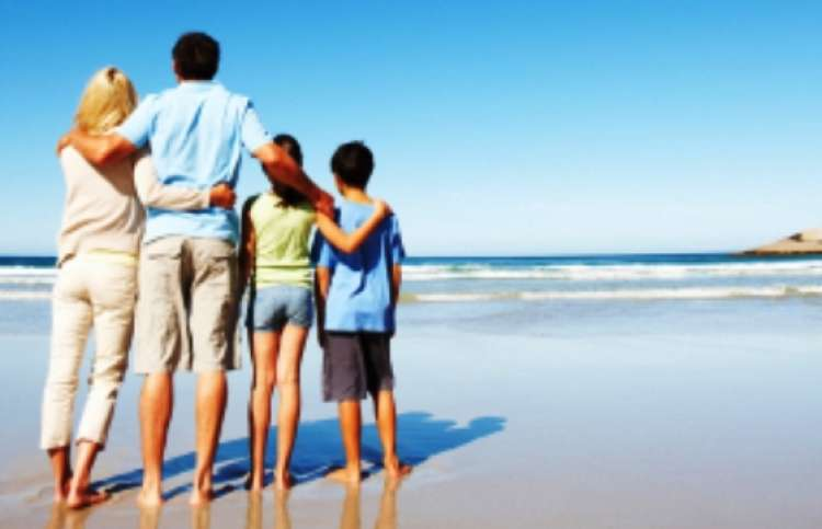 A happy family on vacation at the ocean