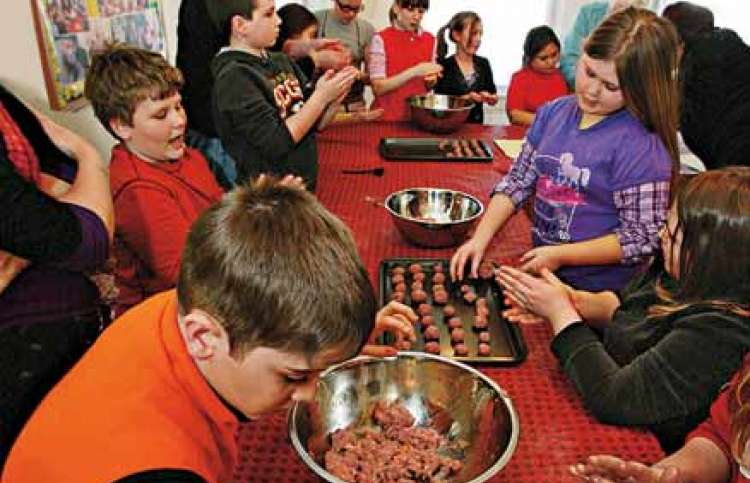 A retiree shares her faith by inspiring a group of children to learn to cook.