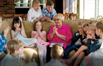 After the Easter egg hunt, Mary Lou delights in leading the grandkids in a song and a story.