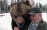 Sulo hand-feeds one of his bears.