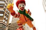 The giant Ronald McDonald balloon soars over the streets of Manhattan