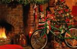 A bicycle with a ribbon under the Christmas tree