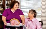 Lori Durham places an Easter ham on the table for her husband, John.