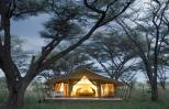 A spacious, well-lit tent of the type used on high-end African safaris