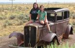 Marci's daughters Sarah and Emma perch upon an vintage car along Route 66