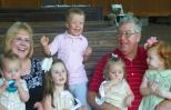 Michelle Cox with husband and grandchildren