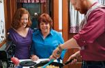 Peggy Frezon, her daughter, Kate, and her son-in-law, Aaron, in the kitchen