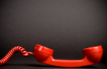 red telephone in an off the hook position