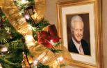 A photo portrait of Rick Moore's father next to a fully decorated Christmas tree