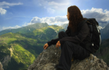 woman on mountain top with beautiful sunrise