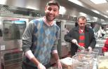 Ben Simon, founder of Food Recovery Network, and students boxing up food