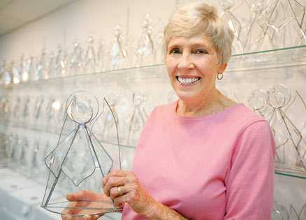 Bobbie Burnett with the stained glass angels that bring hope to cancer patients.
