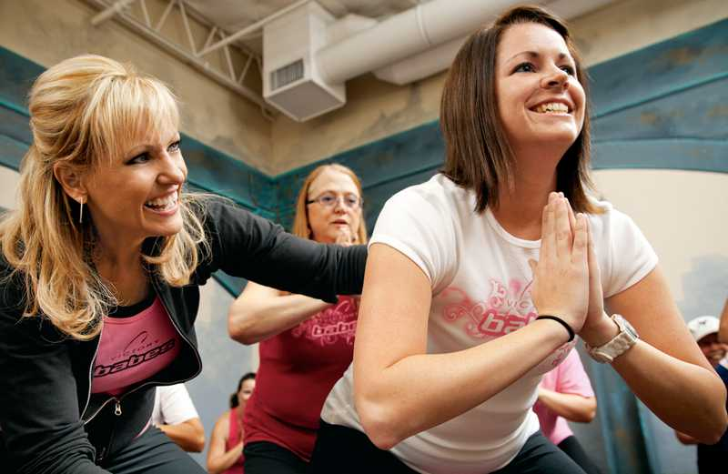 Barb Swanson (left) encourages one of her B.A.B.E.S. during a workout.