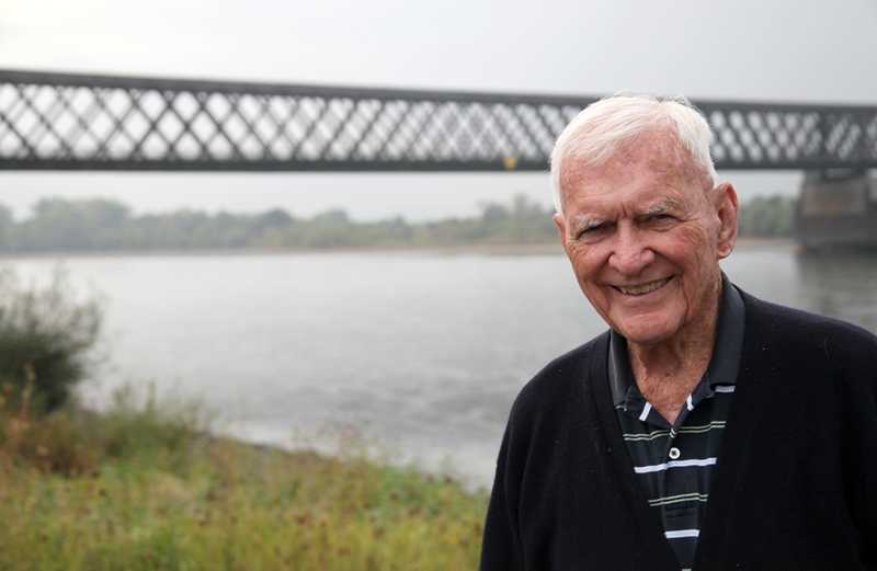General Albin Irzyk poses in front of the bridge over the Eichel River.