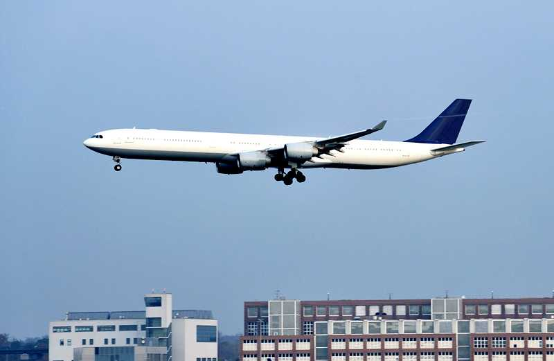 An airliner taking off from a metropolitan airport