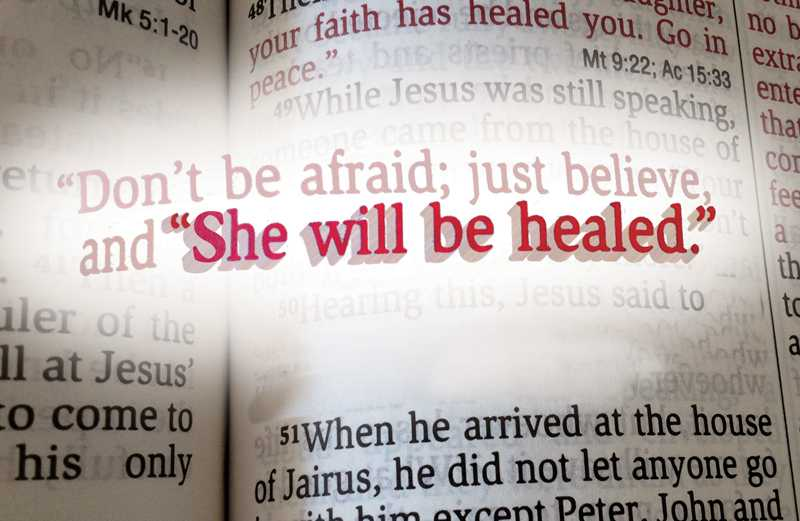 Sue's healing verse is highlighted on a page of the Bible.