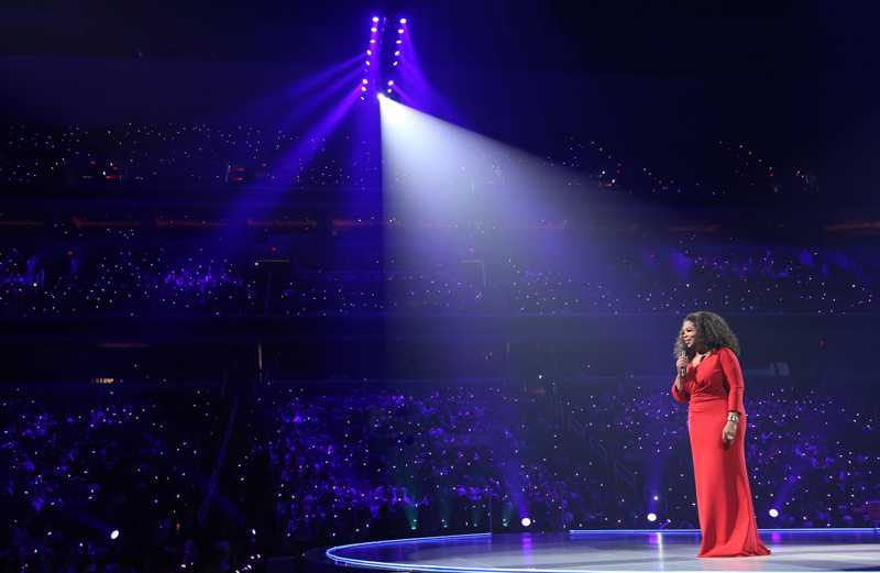 Oprah Winfrey in the spotlight on stage at the Verizon Center