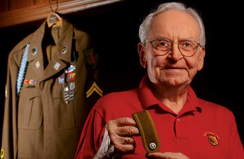 Roy Shull displays the shoulder patch Alois Wagner gave him.