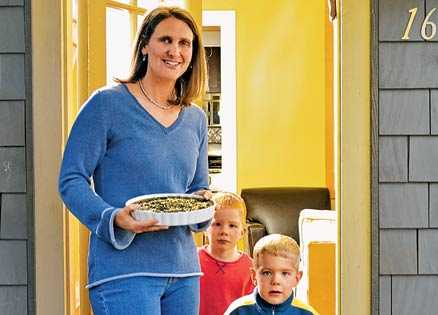"Suzane Schlosberg and her kids prepare to deliver a ""good neighbor"" meal"