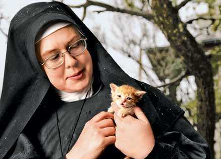 Sr. Michael Marie with tiny kitten. She practices her faith by rescuing animals.