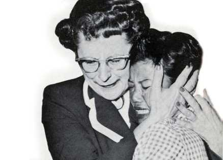 Edith Taylor and Aiko embrace at the airport