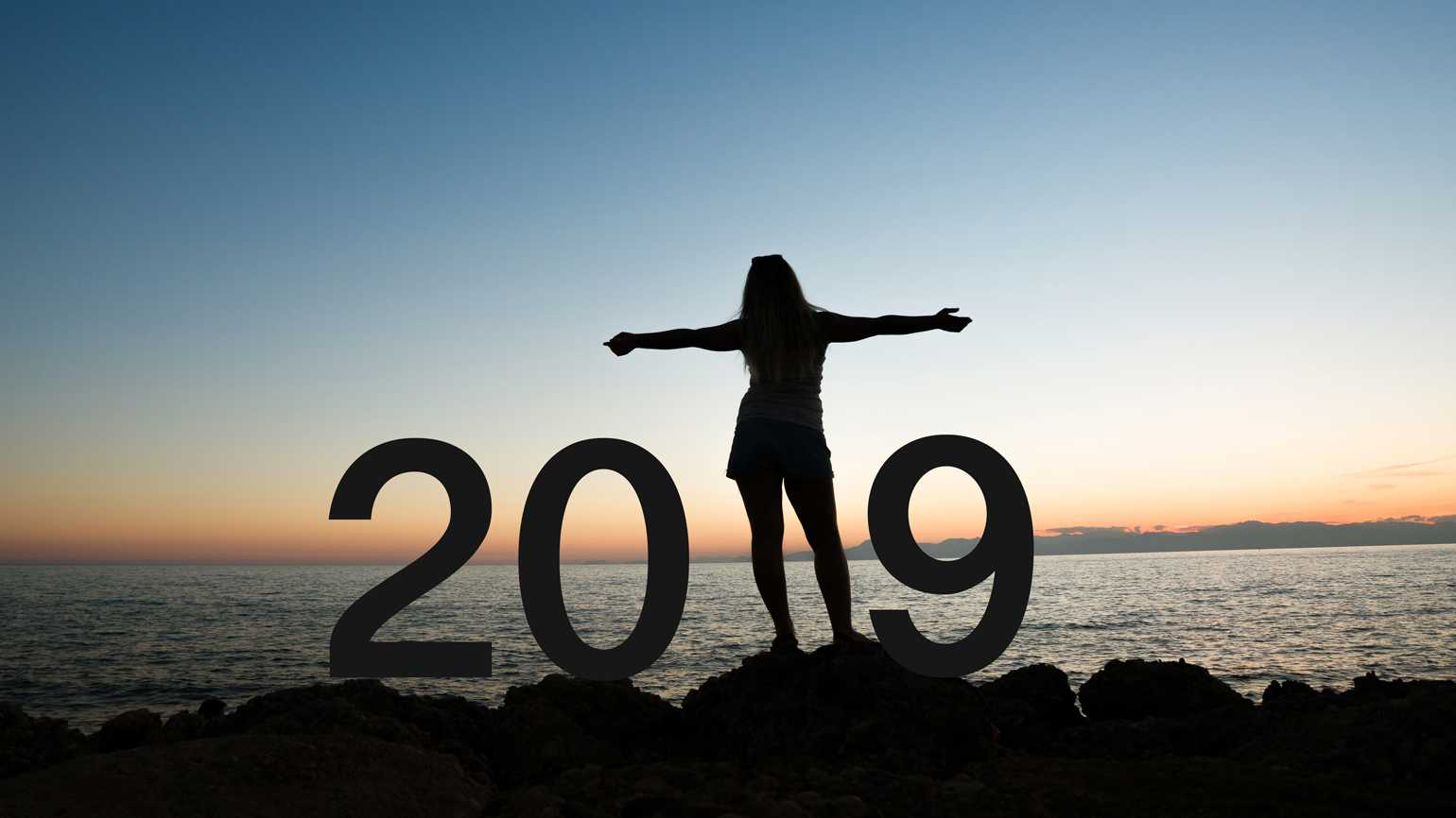 A woman on a beach greets the new year with a hopeful attitude