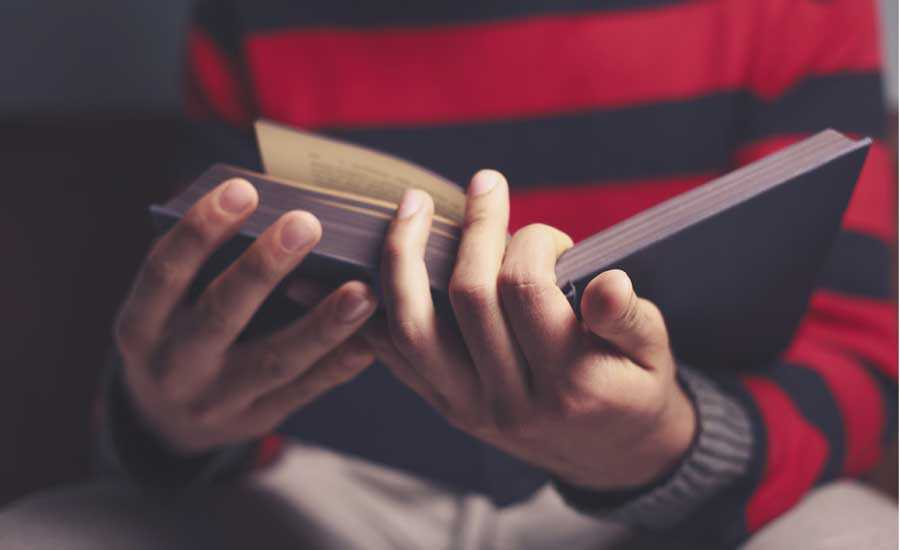 Man Reading Book - Thinkstock
