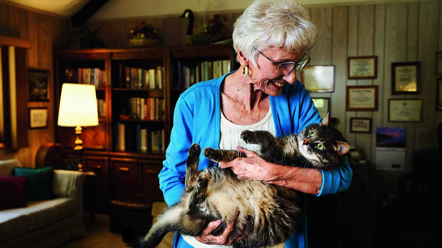 Carol and her favorite feline, Luna, whom she adopted from a shelter.