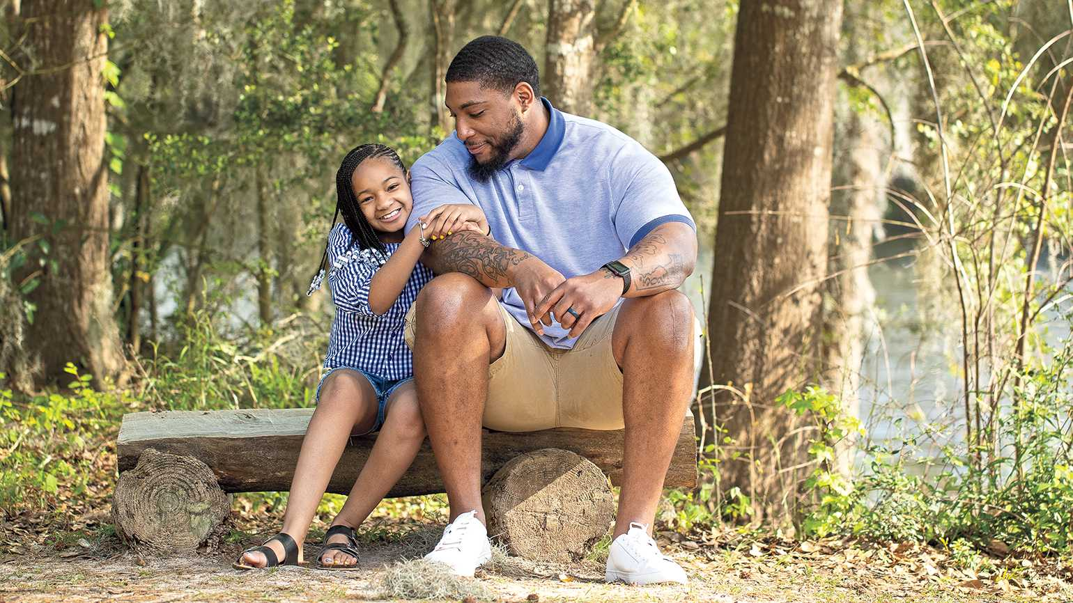 Devon with his daughter, Leah, near his Houston home