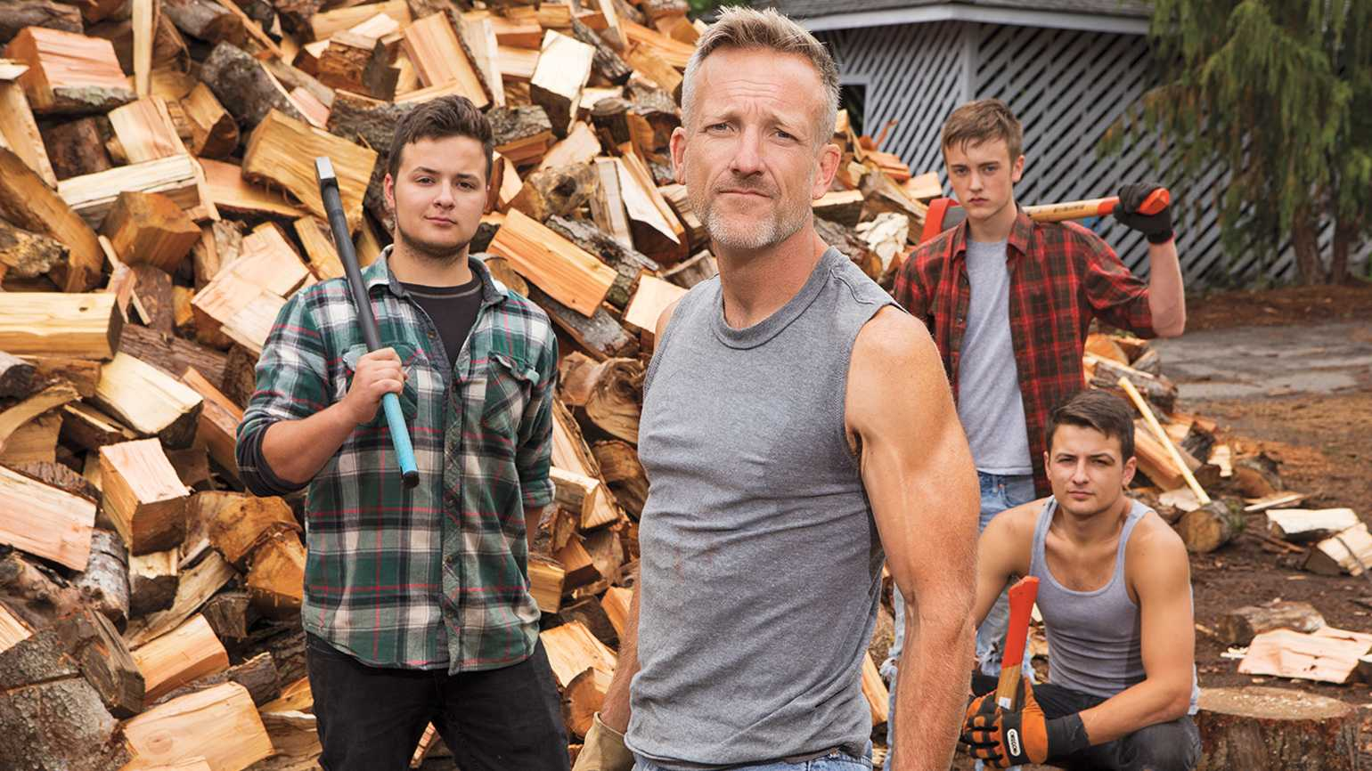 Shane McDaniel and his sons (from left) Harrison, Wyatt and Henry in front of their pile of charity firewood.