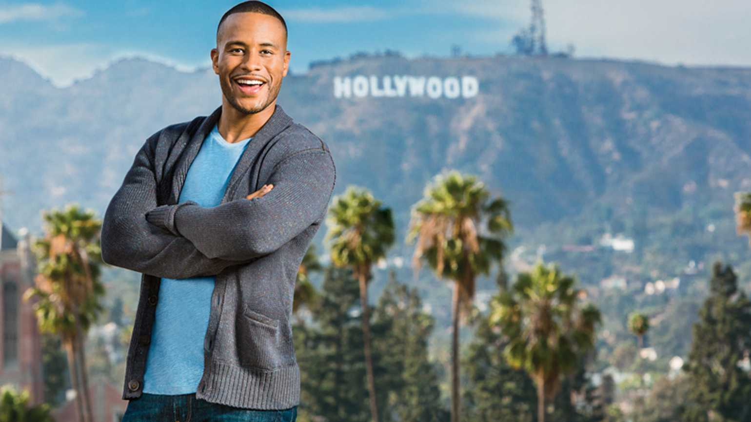 DeVon Franklin poses with the landmark Hollywood sign behind him.