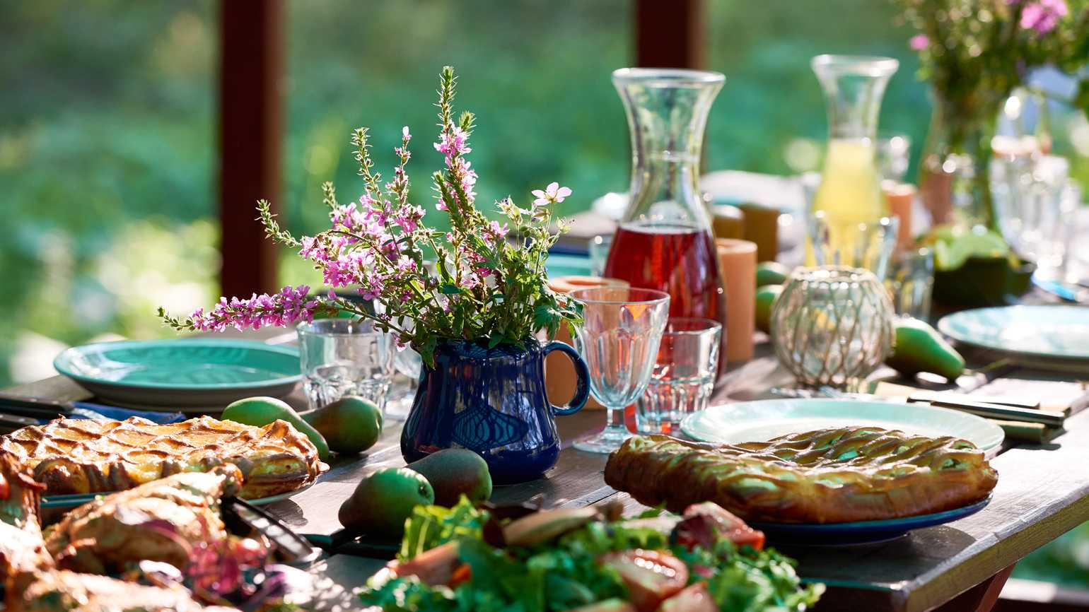 Festive table with food and drinks on it