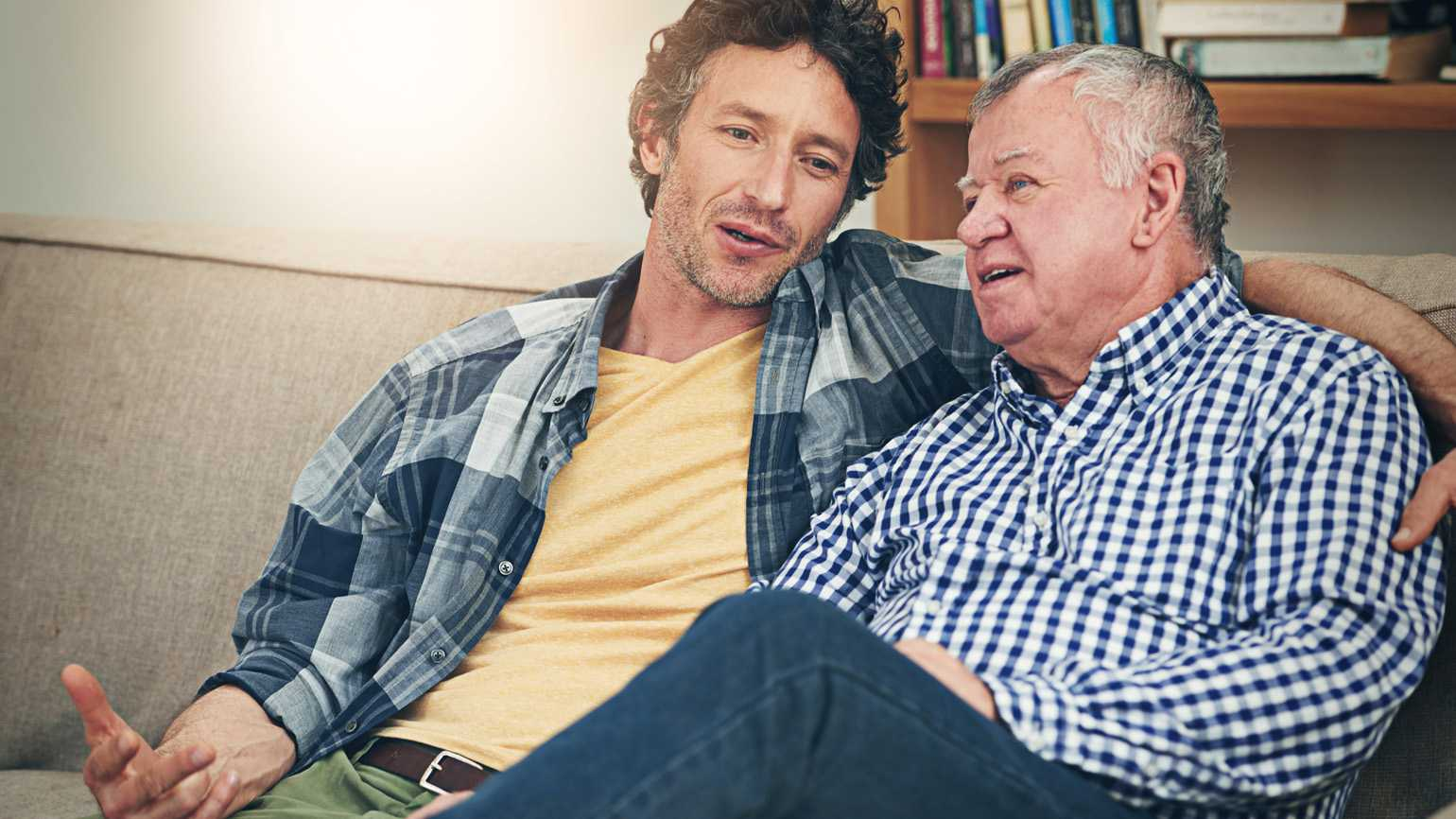 A caregiver has a sit down conversation with his senior father.