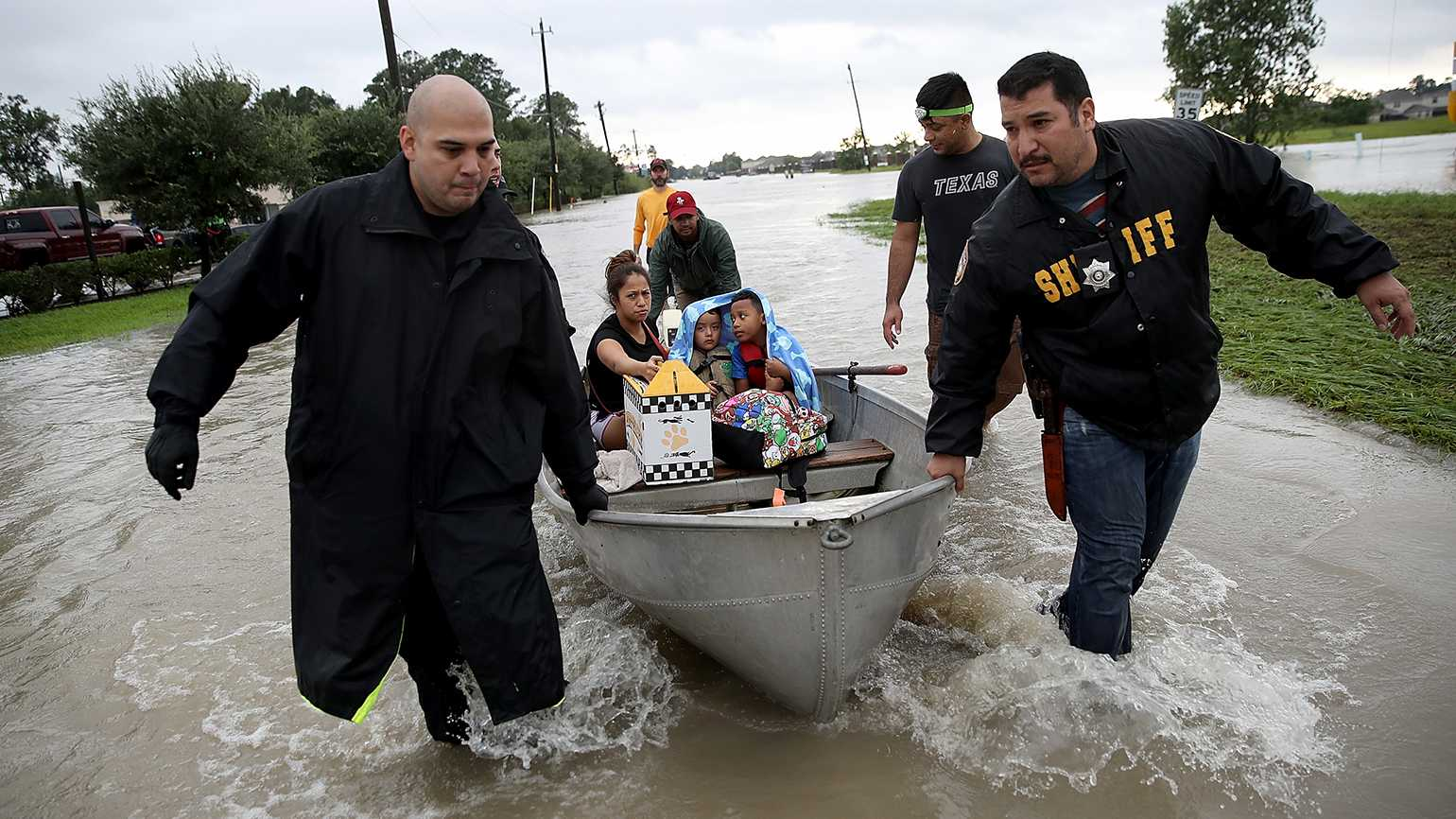 A family is evacuated from its home after severe flooding following Hurricane Harvey in north Houston