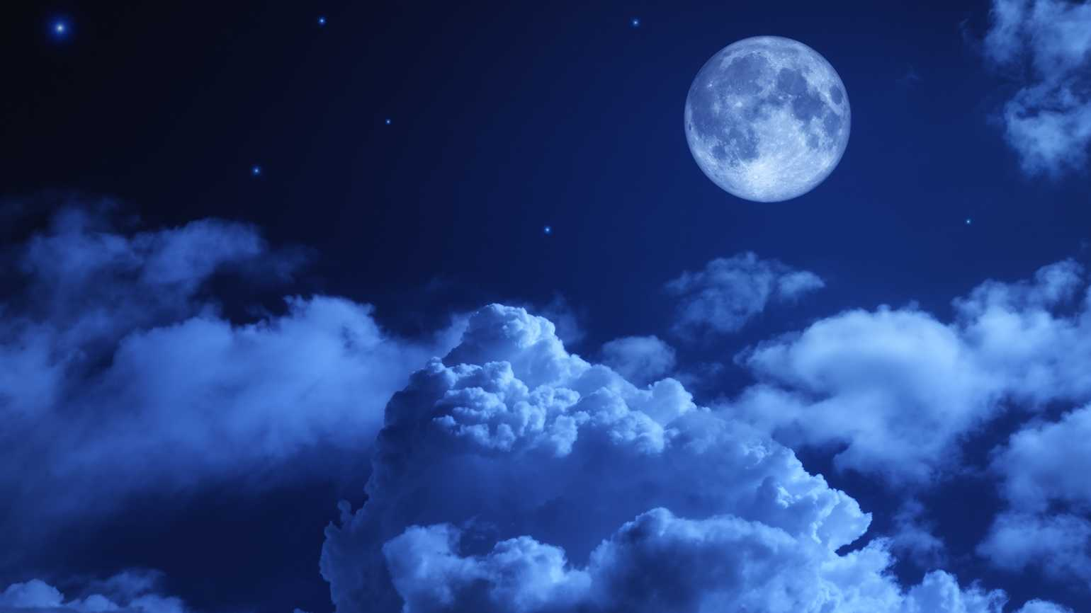 Puffy clouds on a moonlit night