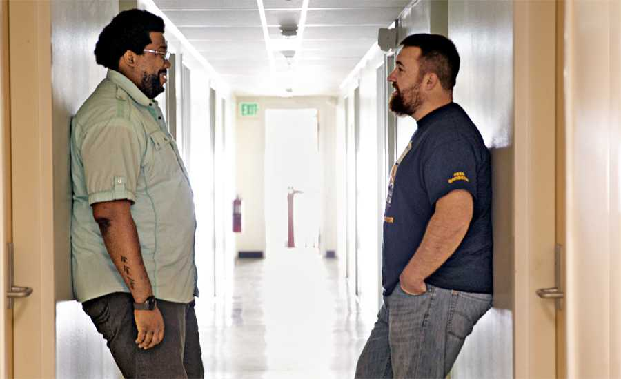 Guideposts: Volunteers of America's Jim Zenner (right) chats with a fellow veteran.
