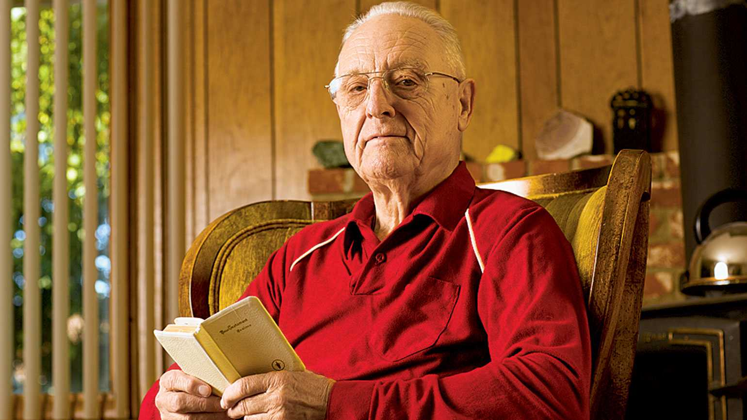 Al McDowell holds the small, white Bible he received in the military