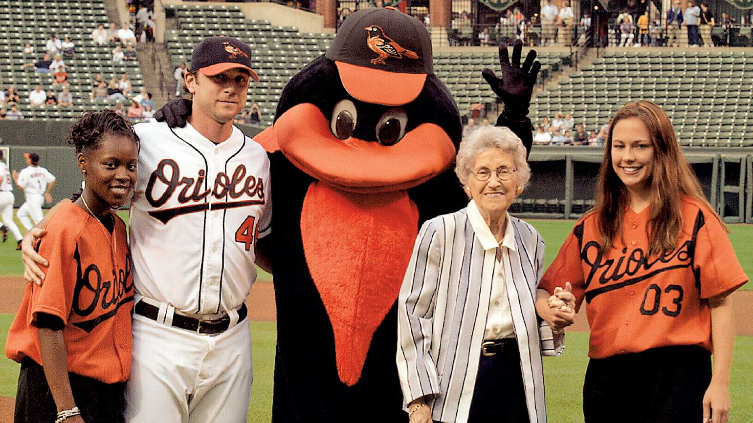 Peggy Rowe's mom with the Orioles' ball girls, mascot and pitcher Kerry Ligtenberg