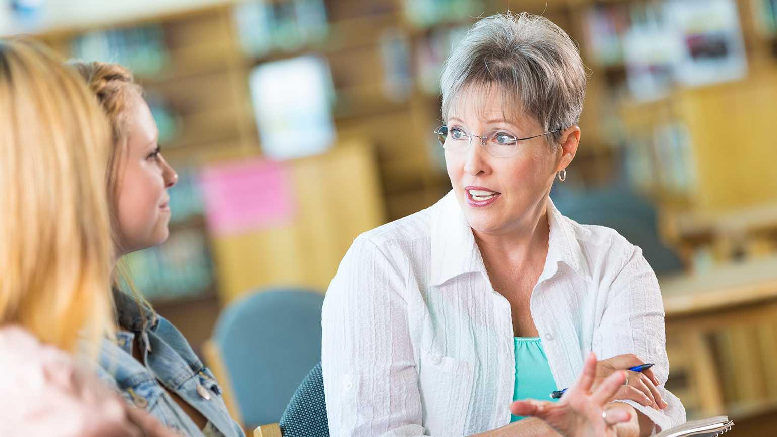 A retiree who now works as a counselor speaks to some of her young clients