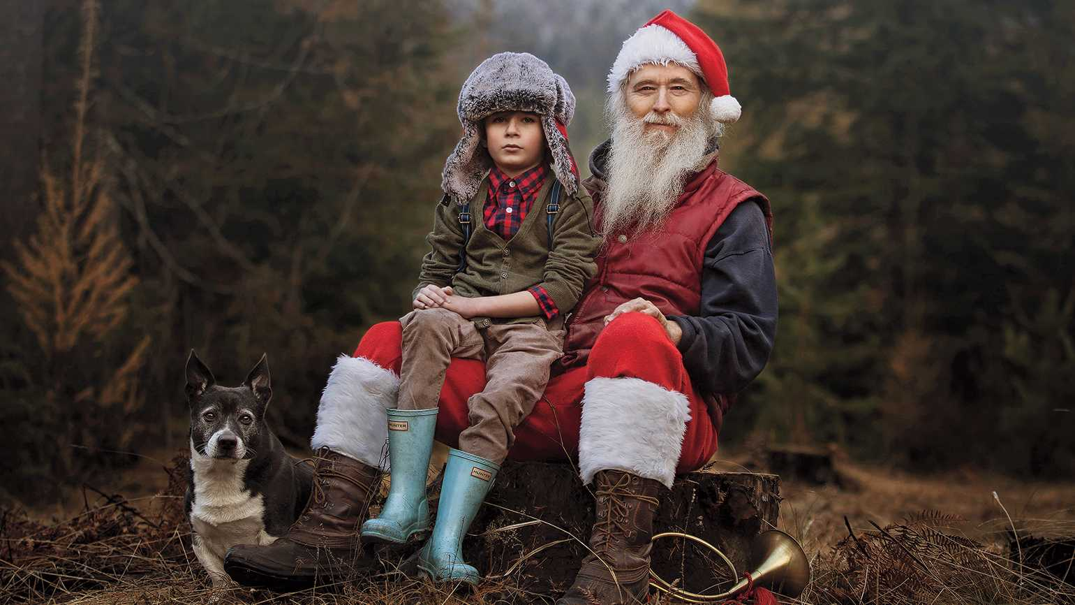 Robin's son Ryder poses with Santa Claus and his dog at the Christmas-tree farm