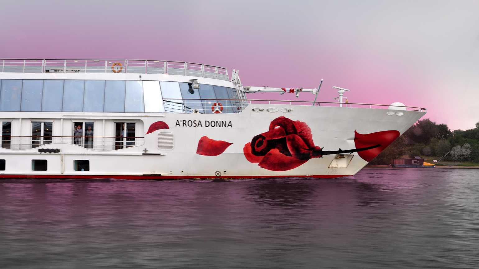 A cruise ship with A long-stemmed Rose and 'A'Rosa Donna' imprinted on the side.